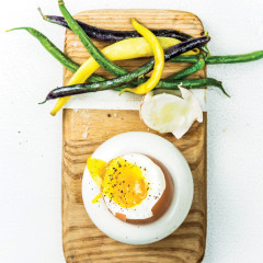 Soft-boiled eggs with garlicky beans