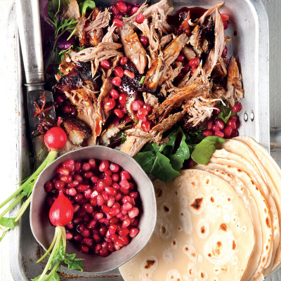 Asian-style duck pancakes with sticky sauce and pomegranate rubies