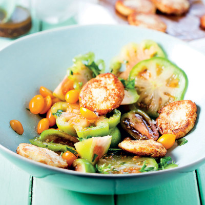 Exotic tomato salad with ricotta fritters and tomato-seed dressing