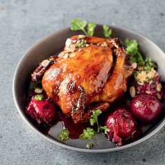Sticky plum chicken with coriander and almonds