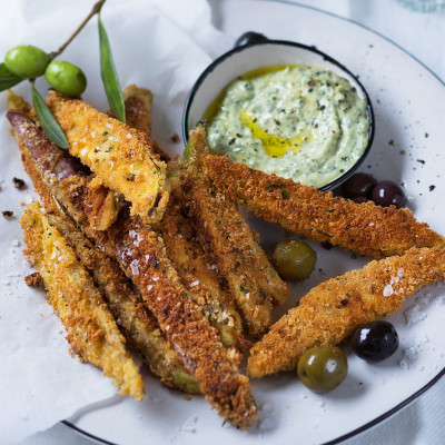 Parmesan-crumbed brinjal with marinated olives and basil pesto mayo