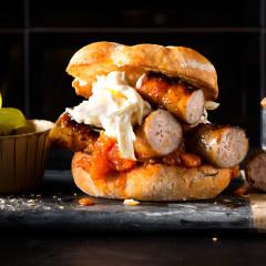 Spring onion-and-feta pork sausage burger with relish and celeriac slaw