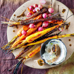 Roast black garlic with poached carrots and honey radishes