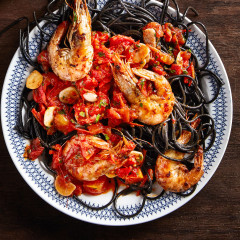 Squid ink pasta and prawns all'amatriciana