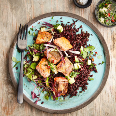 Black rice with avocado and seared salmon