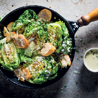 Not-quite-a-Caesar salad with charred gem lettuce and anchovy toast