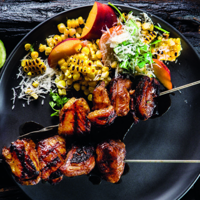 Maple-and-balsamic duck skewers with charred corn salad