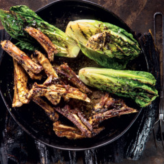 Lamb ribbetjies with black garlic butter and charred lettuce