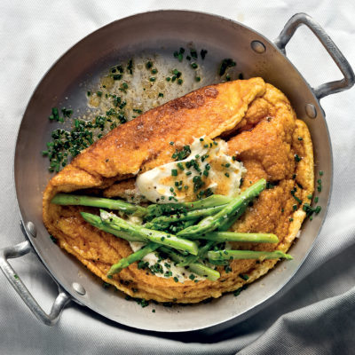 The ultimate soufflé omelette with chive crème fraîche and asparagus