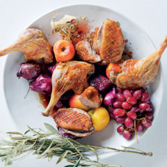 Duck with poached peaches, roast red onions and glazed red grapes