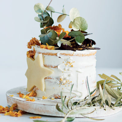 Meringue cake with cream cheese icing and caramel cornflake crown