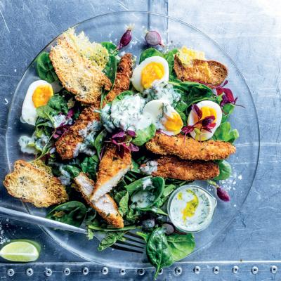 Crunchy fried chicken with buttermilk Caesar-style dressing