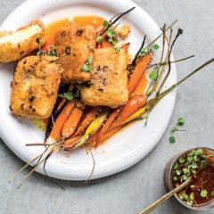 Asian carrot juice dipping sauce with crispy tofu