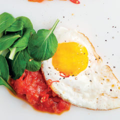 Bhisto with fried eggs