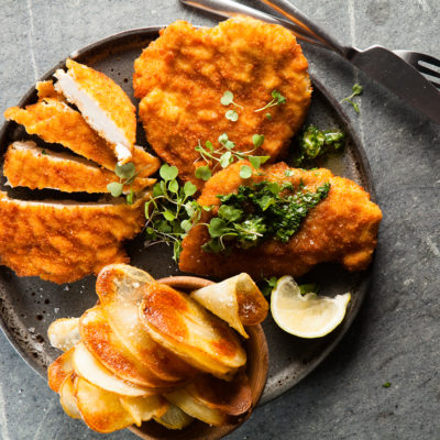 chicken-schnitzel-with-easy-sheet-potatoes-and-coriander-butter