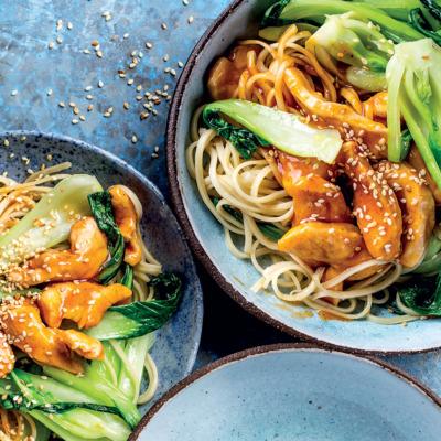 Glazed sesame-chicken noodles with pak choi