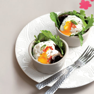Hot Turkish eggs with brown mushrooms