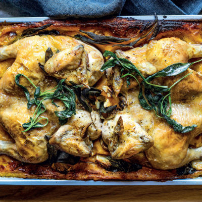 Roast butterflied chickens on pumpkin polenta