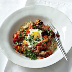 Spicy poached eggs with pepper, brinjal and tomato
