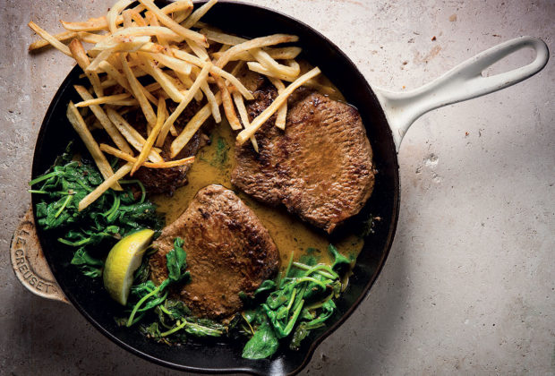 steak with anchovy-spinach sauce and matchstick fries