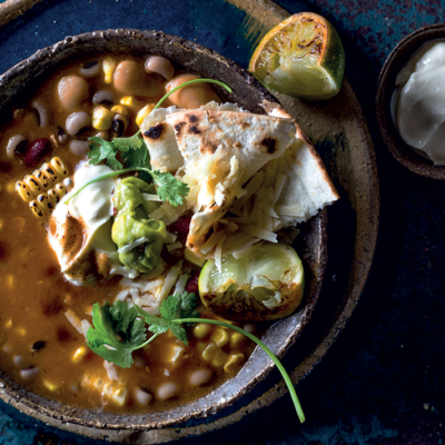 Black bean and coriander soup with zesty guacamole