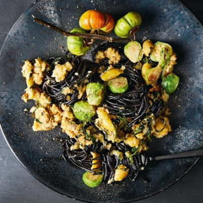 Cuttlefish-ink spaghetti with green olive sourdough sauce and Brussels sprouts