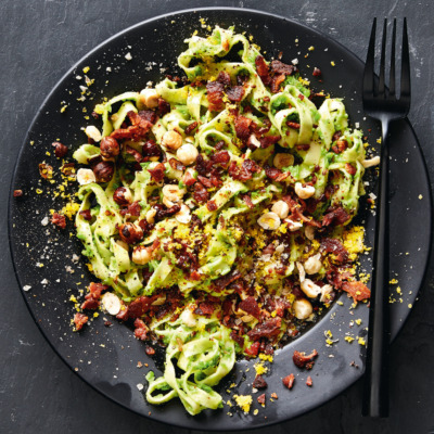 Tagliatelle with mint pea purée, toasted hazelnuts, bacon and cured egg yolk