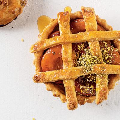 Peach-and-cardamom pies with brown-sugar lattice crust