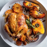 Sticky ClemenGold-glazed roast chicken with pumpkin wedges recipe