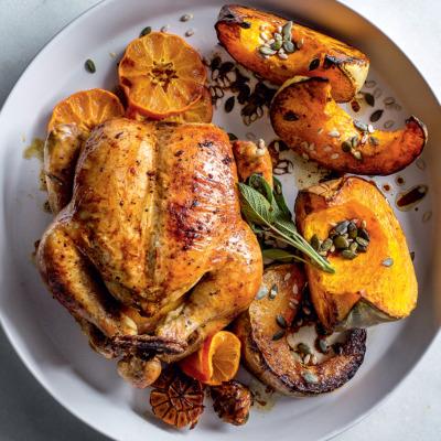Sticky ClemenGold-glazed roast chicken with pumpkin wedges