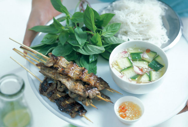 Grilled lemongrass beef skewers with lettuce, herbs and dips recipe