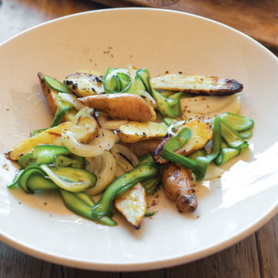 Grilled pink fir potatoes with pickled cucumber salad
