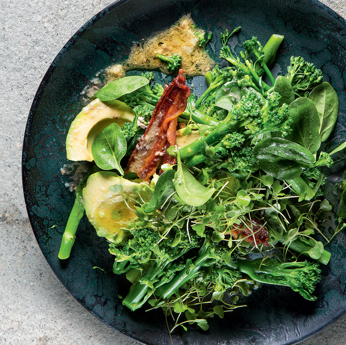 Tenderstem broccoli, avocado and bacon dressed with warm anchovy butter recipe