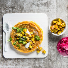 Omelette wraps filled with spicy coconut-fried potato