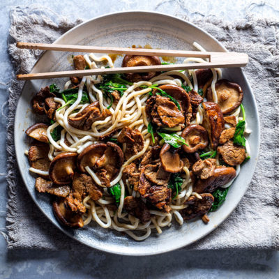 Teriyaki pork and mushrooms on spinach noodles
