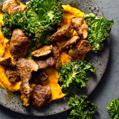 Chicken livers with carrot mash and crispy kale
