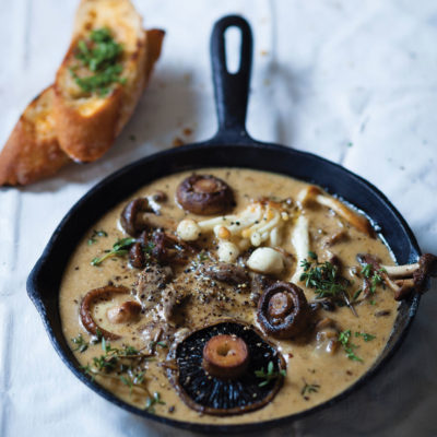 Mushrooms with roasted garlic cream and herb-buttered toast