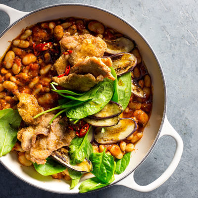 Spicy Spanish beans with crispy pork fillet