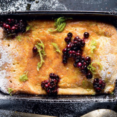 Zested oven pancake with warm blueberries