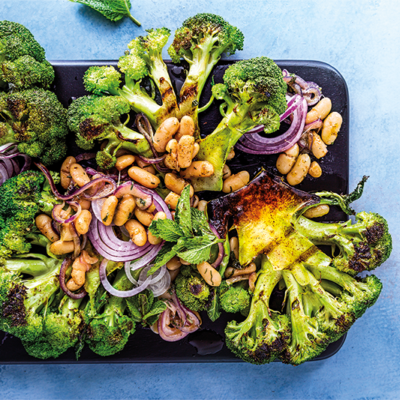 Grilled broccoli steaks with white beans, red onions and anchovy butter