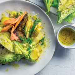 Steamed cabbage wedges and trout with lemon and dill