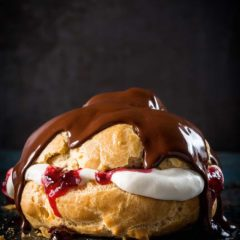 Chocolate éclairs with cherry jam
