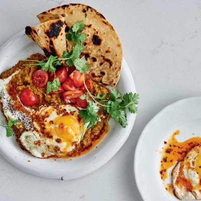 Spicy fried eggs on dhal with yoghurt-sumac sauce