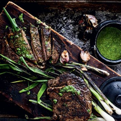 Steak with chargrilled spring onion butter