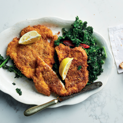 Grana Padano-and-coppa crumbed chicken with sautéed kale