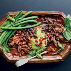 Cheat's <em>feijoada</em> with shredded pork shoulder and creamy rocket hummus