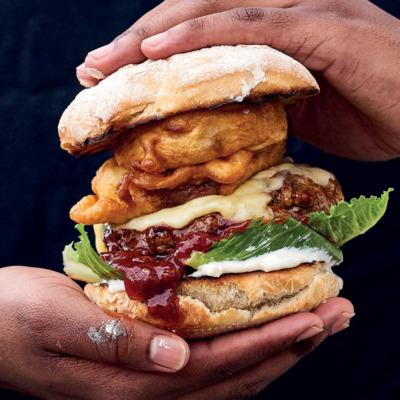 Hand-cut rump burgers with onion rings and monkeygland sauce