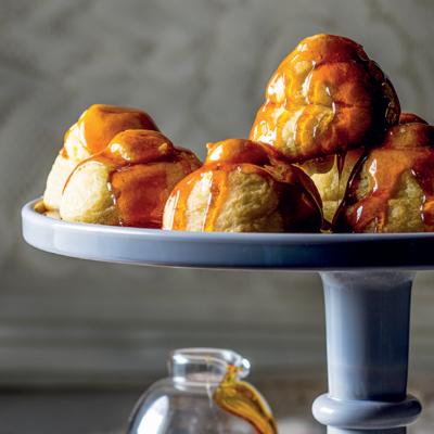 Sweet profiteroles with créme pâtissière and caramel