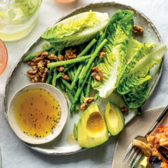 Green salad with roast walnuts and avocado oil dressing
