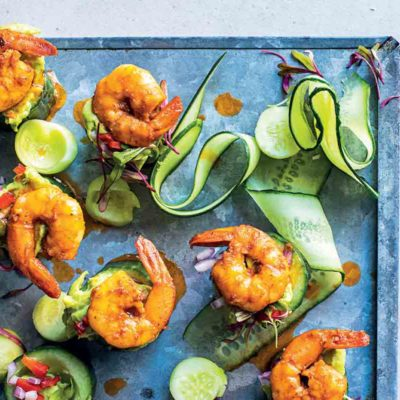 Spicy prawns and guacamole in cucumber cups